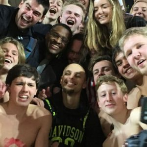 Curry celebrates Davidson win in student section